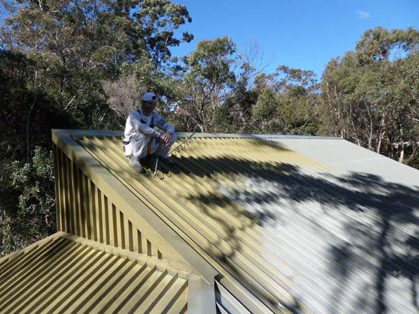 Pros and cons of roof painting in Sydney vs Re-roofing