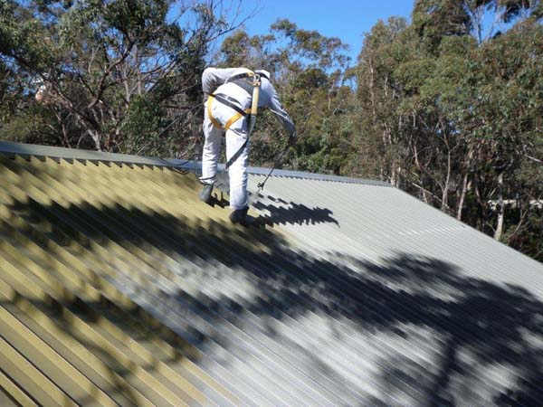 High quality roof spraying Sydney in action with Summit Coatings